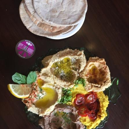 Old Bay, Everything Bagel, Kalamata Olive, Traditional and Smokey Turmeric Hummuses with wheat pita